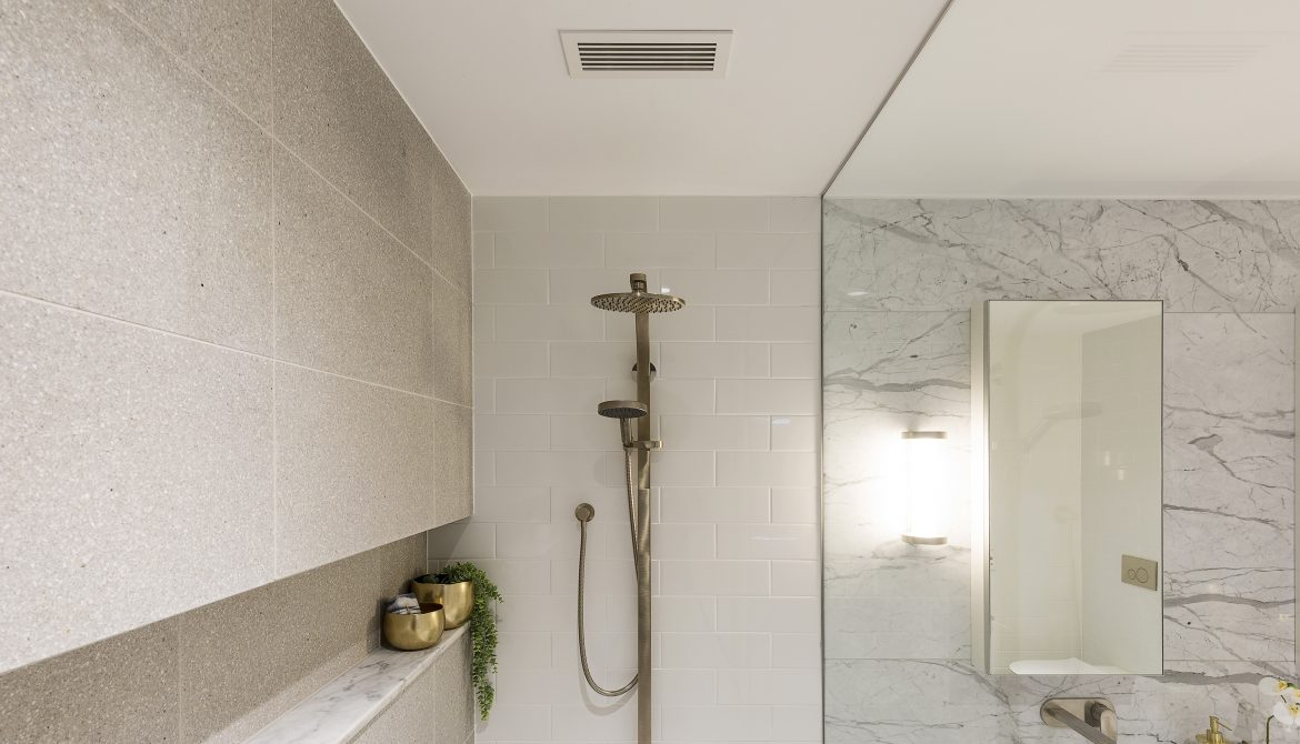 The Compact Linear Bar Grille sits discreetly over the shower, part of the ventilation system at Montefiore Aged Care