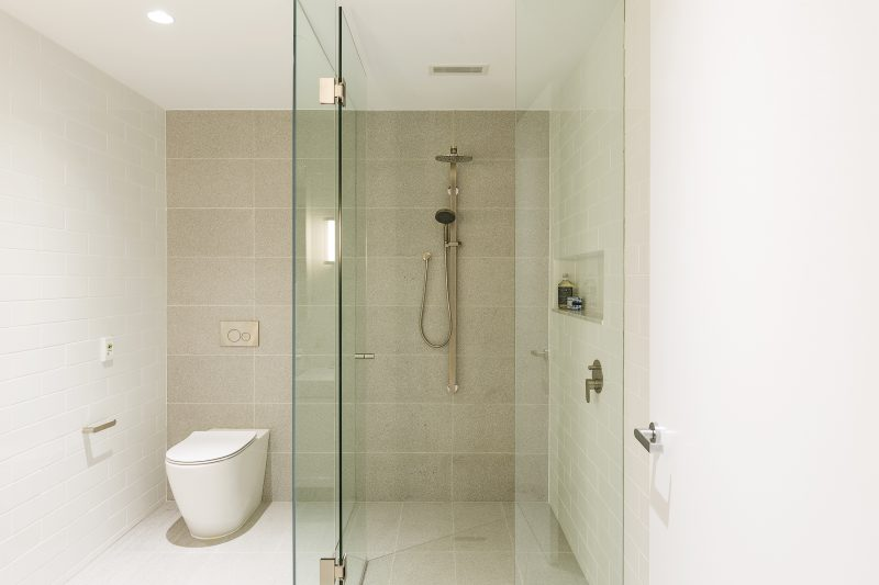 The bathroom design at Montefiore Aged Care is shown with the Compact Linear Bar Grille installed on the ceilings