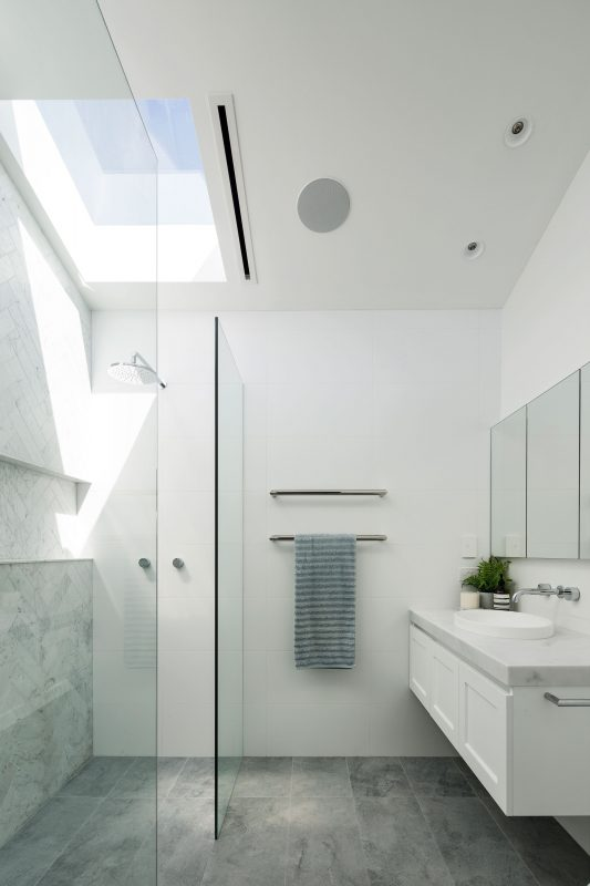 Newly renovated ensuite with a raked ceiling and a skylight with Expella's Linear Slot Grille installed