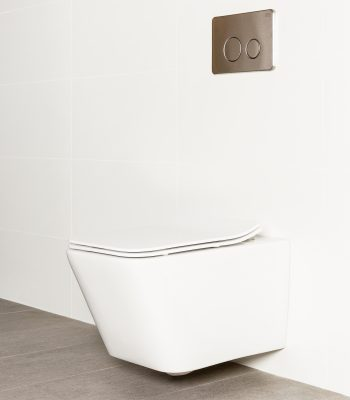 Milu Form in-wall wall mounted odourless toilet, has a rectangular shaped pan with a strong minimal design. The toilet is mounted on a white tiled wall