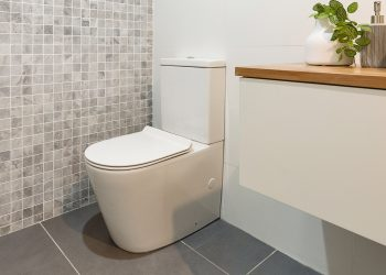 Mod back-to-wall Milu Odourless toilet installed in modern bathroom with marble mosaic tiles