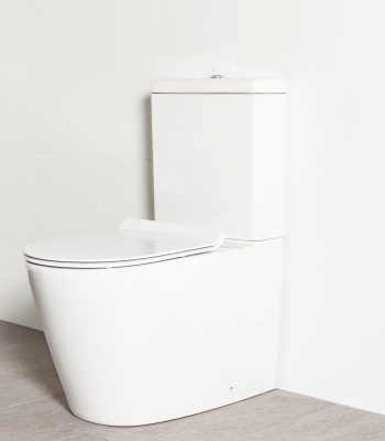 Milu Odourless Mod back-to-wall toilet pictured against a white tiled wall