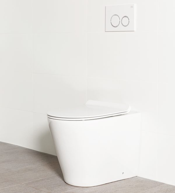 Milu Odourless Mod in-wall floor mounted toilet shown with a white flush plate. Pan design design has a straight profile, the cistern is hidden behind the wall